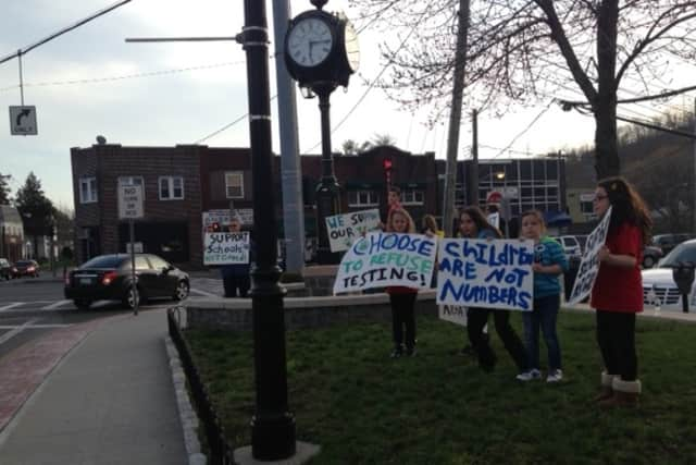 Several Elmsford parents and students took to the streets Tuesday evening to protest state testing.