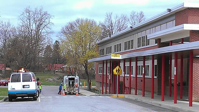 Con Edison crews work on a gas line issue at Frank G. Lindsey Elementary School Thursday morning.
