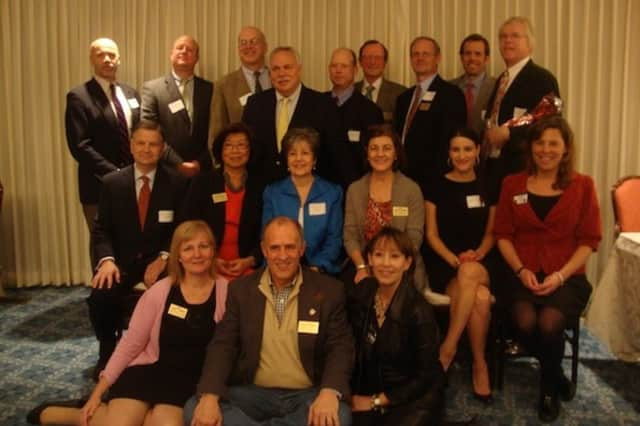 Members of the Darien Chamber of Commerce at a holiday party. The chamber will have its ninth annual Going For Green Business Awards April 21.