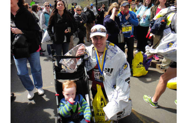 Michael Leonard, pictured with his son Alexander, is among the Boston Marathoners who escaped injury.