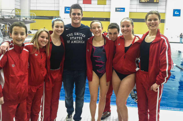 Members of Whirlwind Diving stand  with Olympic gold medalist, David Boudia.. From left are Timmy Luz, Anne Farley, Rachel Burston, David Boudia, Kylie Towbin, Sean Burston, Kirsten Parkinson, and Genevieve Angerame.