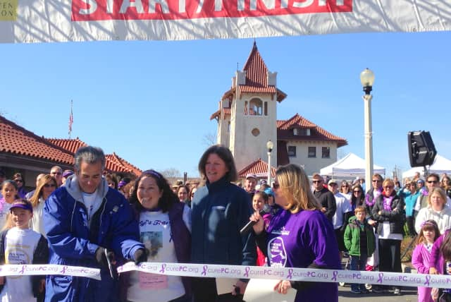 Steve Hernandez and daughter Tara Shanes-Hernandez, who founded the Westchester Pancreatic Cancer Research Walk, Ann Walsh, director of events for the Lustgarten Foundation, and News 12 anchor Lisa LaRocca, who emcee'd the event in Rye.