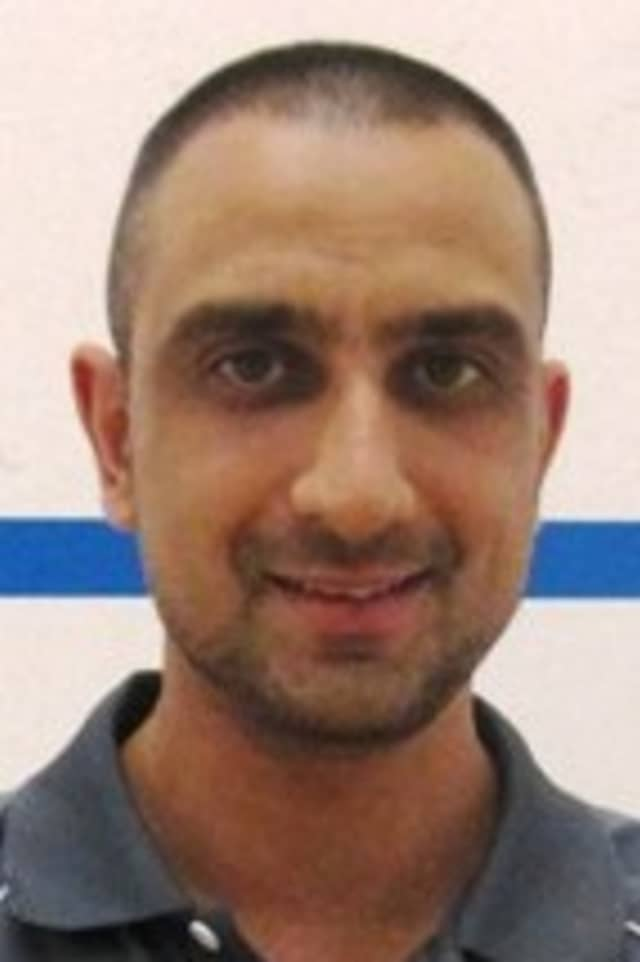 Shahid Khan of Stamford, who teaches at a club in Rye Brook, was named the Pro Squash Tour's Sportsman of the Year.