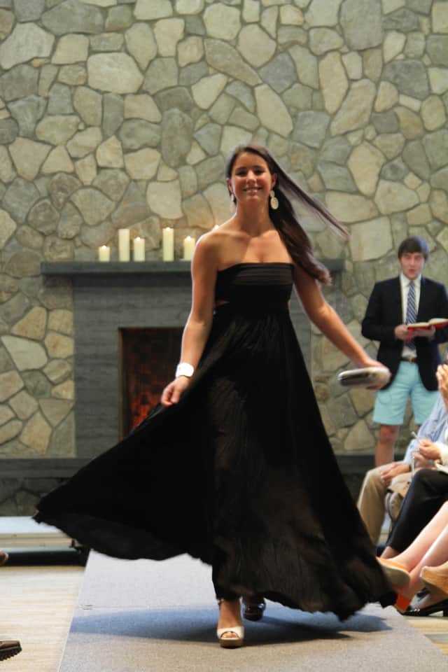 Annabel Holland of Rowayton hits the St. Luke's runway. Jackson Prince of New Canaan, co-Master of Ceremonies, is in background.