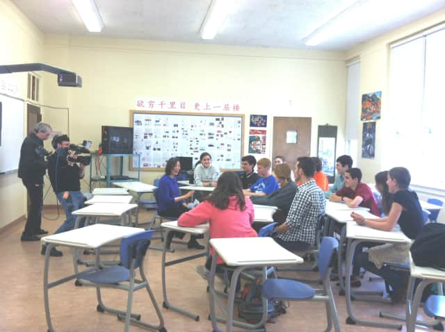 MHS Mandarin students converse in Chinese with teacher Rong Rong Le.