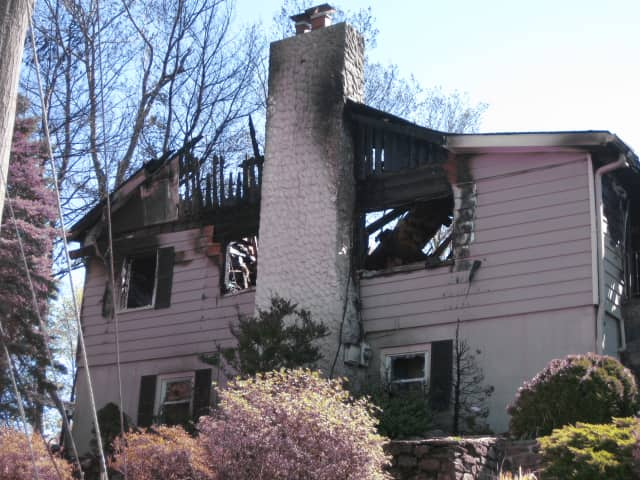 """A home restoration agency employee described the home as """"most likely beyond saving"""" on Friday morning."""
