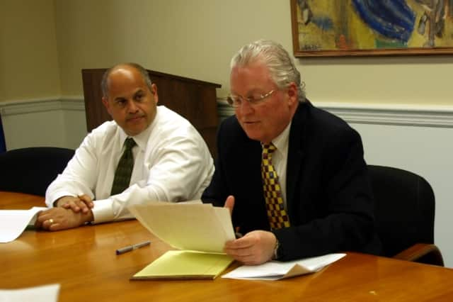 Fairfield First Selectman Michael Tetreau (right) and Public Works Director Joseph Michelangelo speak at a press conference about the 2013-2014 budget Friday.