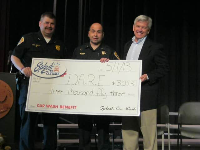 Bedford Detective Bill Smith, left, is joined by Bedford Detective Joe Comunale, and Splash Car Wash CEO Mark Curtis.