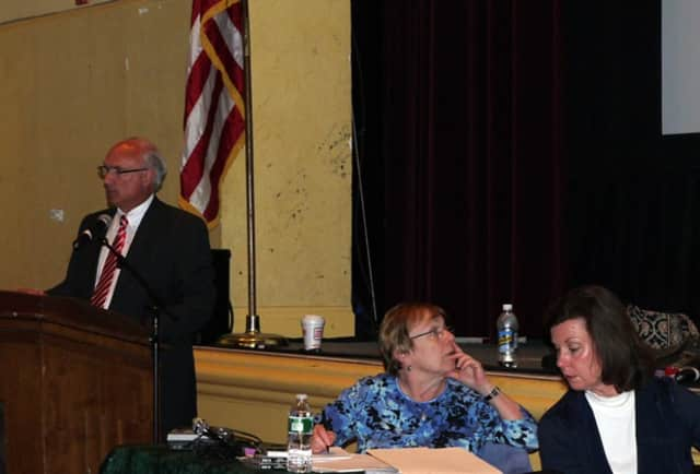 Ridgefield First Selectman Rudy Marconi with Town Clerk Barbara Serfilippi and Selectman Maureen Kozlark are on hand to answer questions regarding the town budget Monday night at the Annual Town Meeting.