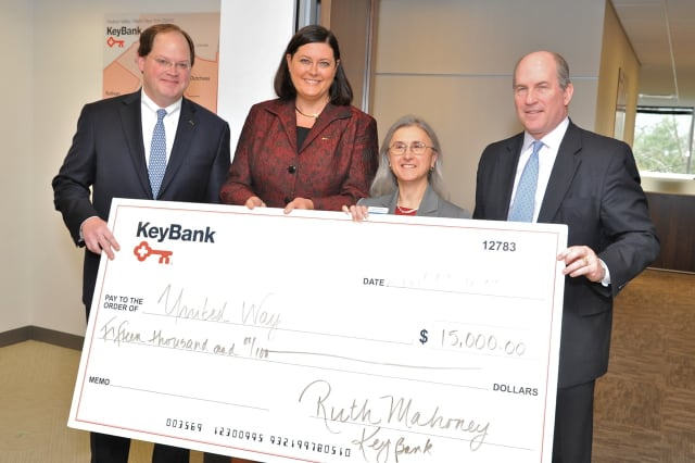 KeyBank officials present a check to the United Way's Carlene Gentilesco.