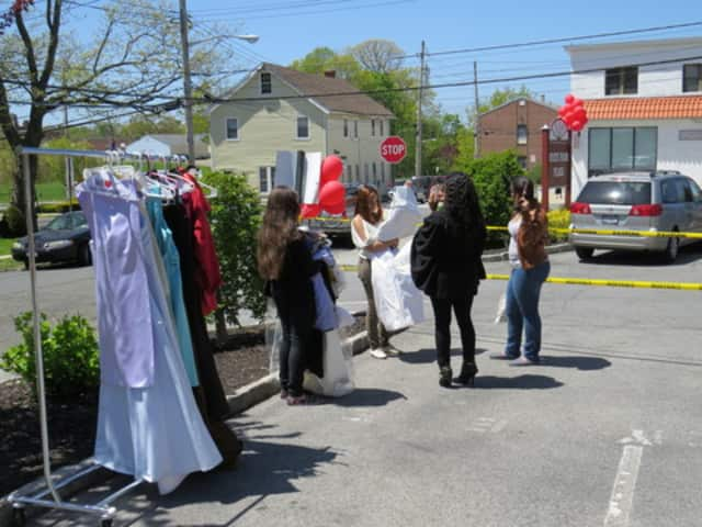 Shoppers peruse $1 prom dresses in Eastchester.