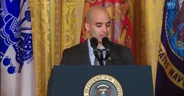 Mercy College graduate student David Padilla of the Bronx introduces President Obama at a White House event for veterans.