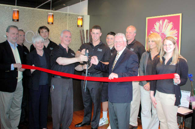 First Selectman Michael Tetreau cuts the ribbon on The Joint's new Fairfield location with the franchise owners earlier this month.