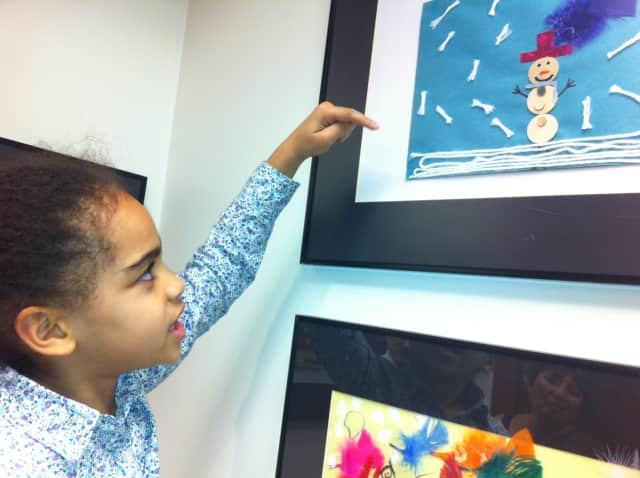 """Highview School student Taylor Hendrickson, shows off her painting titled """"Taylor's Snow Day,"""" during the Greenburgh Central 7 Art Show opening."""