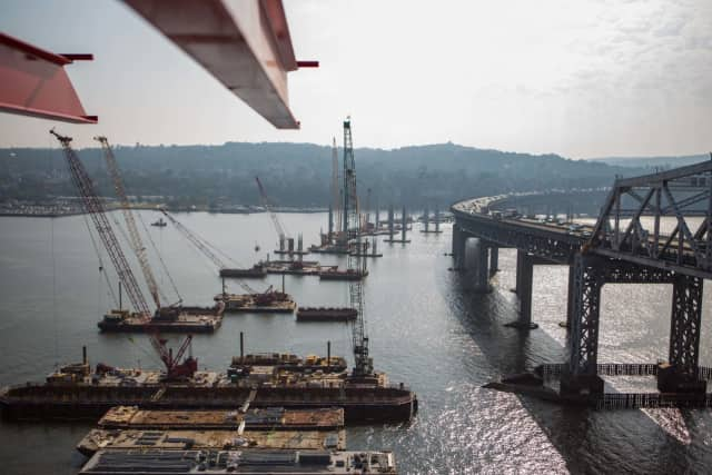A former tugboat worker is suing the contractors working on the new Tappan Zee Bridge, claiming that he suffered paralyzing spinal injuries after being ordered to secure a barge during a storm last year.