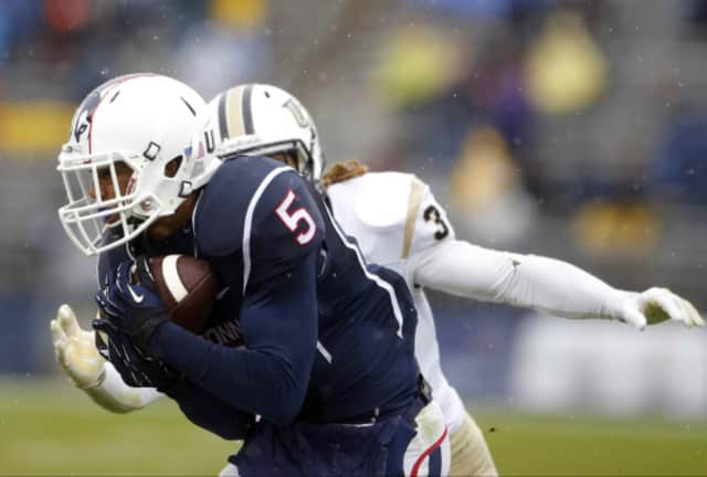 UConn's Noel Thomas, a resident of Norwalk who played in high school at St. Luke's in New Canaan, pulls in a pass for the Huskies in a game last year.