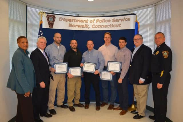 Norwalk Police honored its Officers of the Month. See story for IDs.