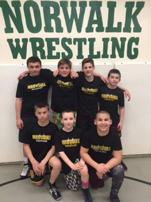 Norwalk Mad Bulls wrestlers standing are (left to right) Jeff Cocchia, Nick Augeri, Dean Tsiranides, and Nick Fatone. Kneeling left to right: Mike Bartush, Mikey Schneider and Jason Singer