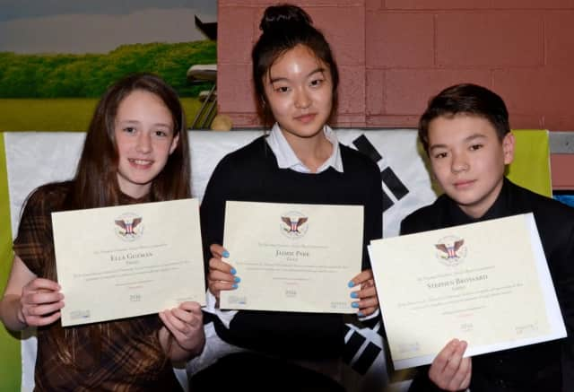From the left, Ella Guzman, Jaimie Park and Stephen Brossard display their certificates from the President's Volunteer Service Award Ceremony.