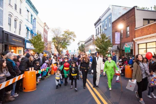 The Bat Family and supervillains Two Face and The Riddler at the Nyack Halloween Parade.