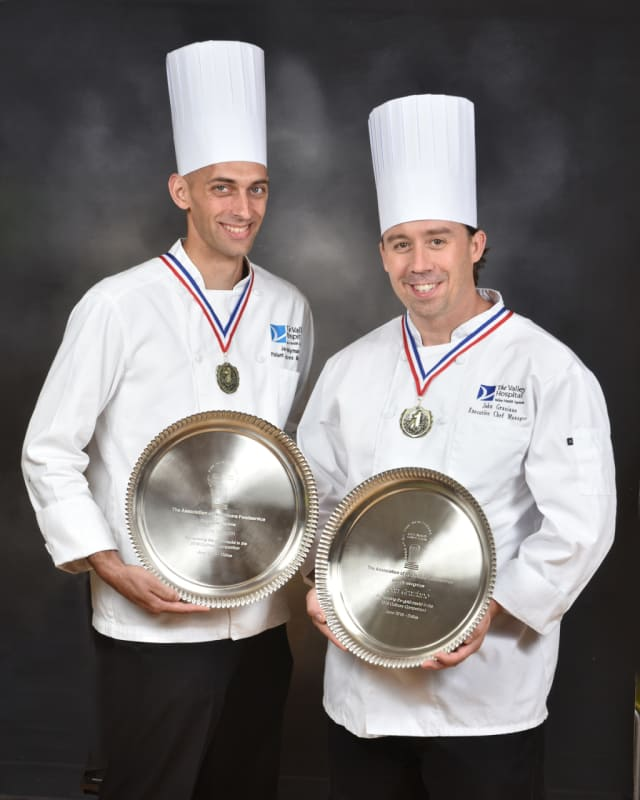 Jason Nyman, Manager of Food & Nutrition of Patient Services (left), and John Graziano, Manager, Executive Chef, (right) with Silver Plate awards for their winning dish at the 2016 Association for Healthcare Foodservice Culinary Competition.
