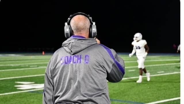 New Rochelle football coach Lou DiRienzo was unexpectedly suspended by the school district.