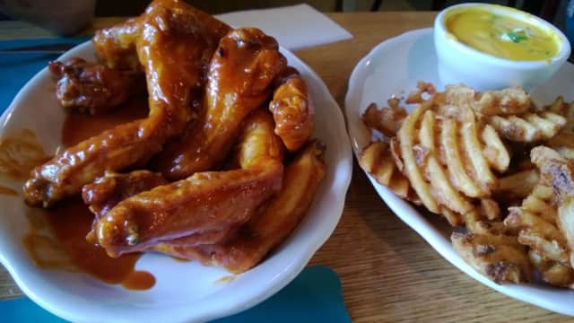 Teriyaki/hot mix of wings and waffle fries with jalapeno cheese sauce at the Candlelight Inn in Scarsdale.