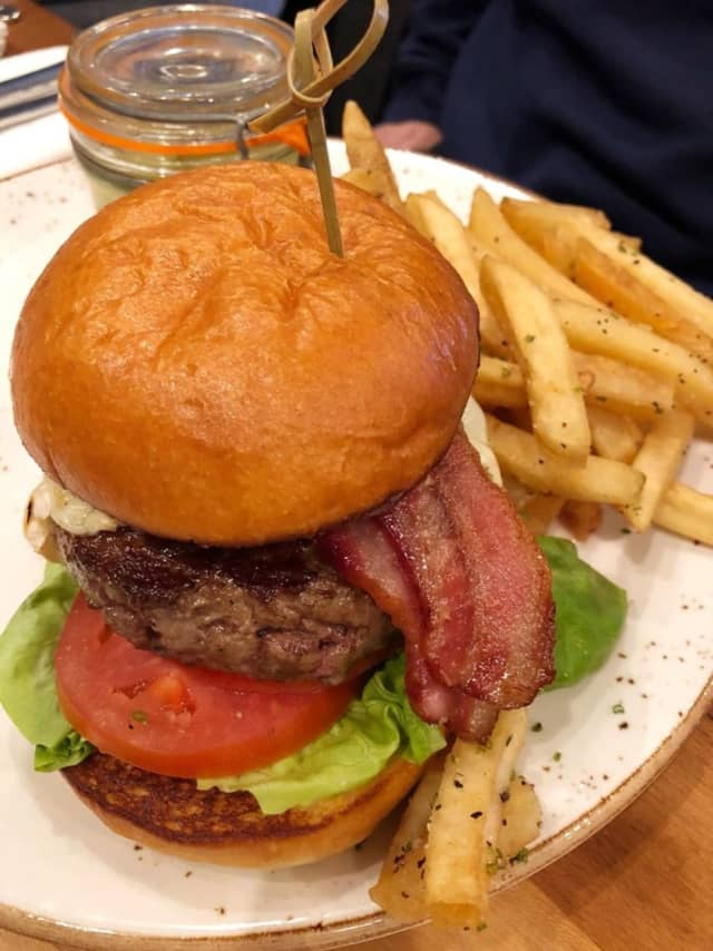 Grass-fed beef burger with french raclette cheese, gem lettuce, tomato, salt and vinegar fries and house-made pickles from Rustic Root in Woodbury (7927 Jericho Turnpike)