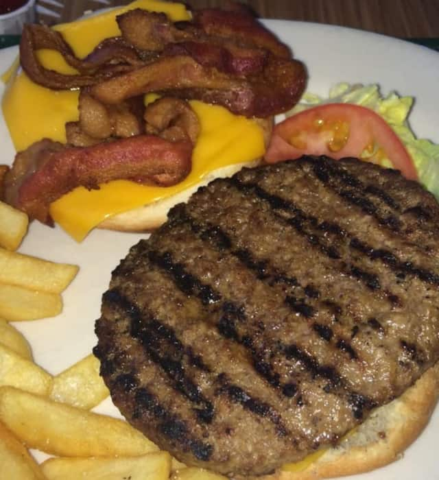 Burgers at the Hearth in Clifton are charbroiled the same way since 1968.