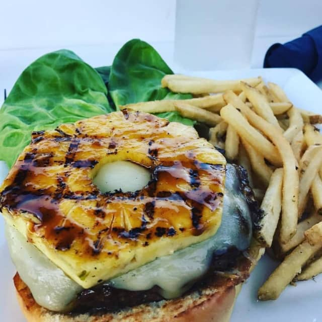 The glazed Island Burger with Angus chuck, jack cheese, lettuce, grilled pineapple and pineapple aioli from RUMBA (43 Canoe Place Road in Hampton Bays)