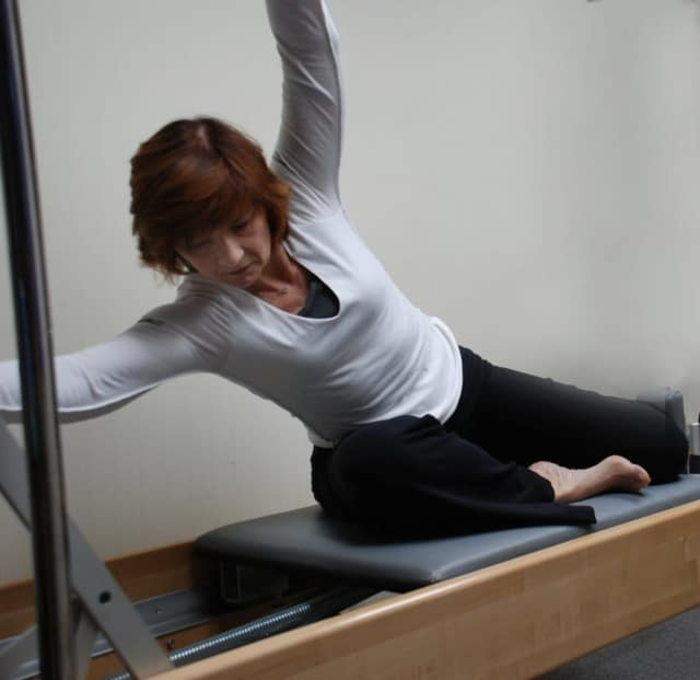 Cathy Konciak doing the Mermaid on the Reformer.