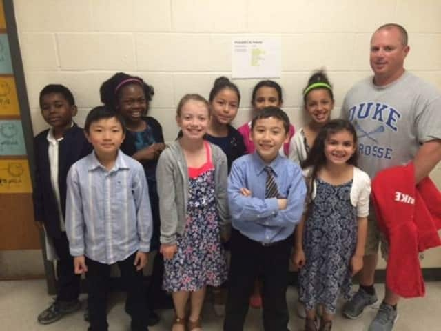 Nine Oakside Elementary School students received Physical Education Awards at ceremonies in Beacon in May. At right is Coach Tim Murphy.