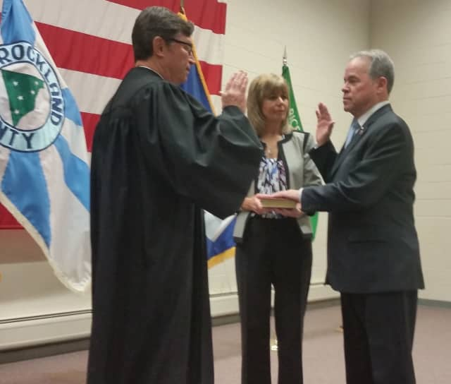 Rockland County Executive Ed Day accompanied by his wife, Jean, takes the Oath of Office, administered by Clarkstown Justice Craig E. Johns.