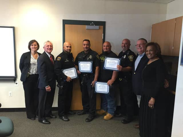 Deputy Chief Susan Zecca, Mayor Harry Rilling, Officer Vidal Gonez, Officer Rich Dellalo, Officer Mark Suda, Officer Russ Ouellette, Commissioner Charles Yost and Commissioner Fran Collier-Clemmons.