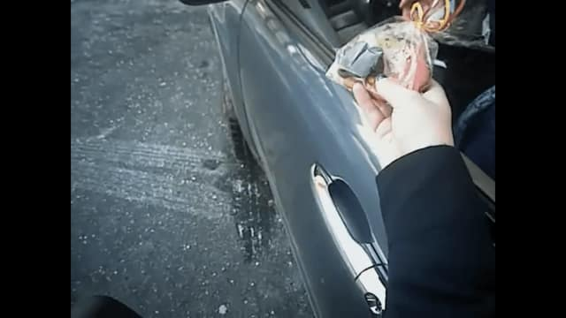 An Ossining police officer hands out cookies to a motorist rather than a ticket.
