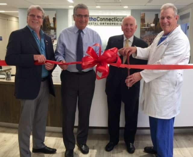 First Selectman Jim Marpe, Dr.'s Nicholas Polifroni and Michael Lynch, and Westport Weston Chamber of Commerce Executive Director Matthew Mandell celebrate the opening of the new OrthoConnecticut in Westport