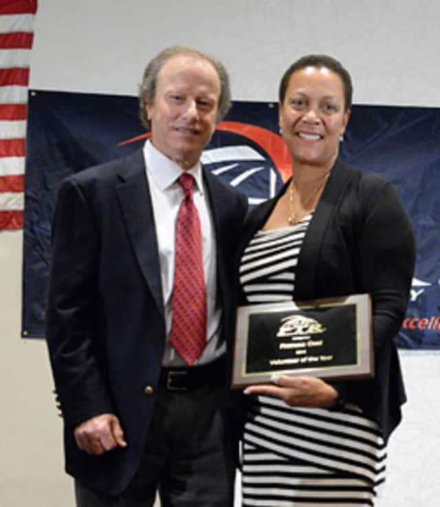 Fran Osei is shown in 2015 with Roy Barth, president, Professional Tennis Registry when she was named the registry's Volunteer of the Year.