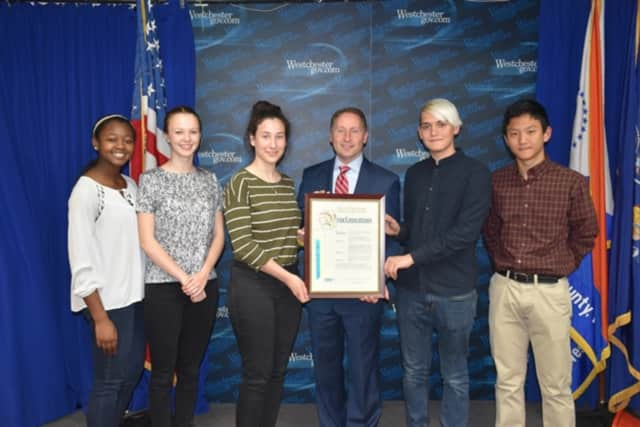 County Executive Rob Astorino honors five students from Ossning High School's Team 10 who placed third overall in the Hudson Valley Regional Envirothon and will advance to the state competition.