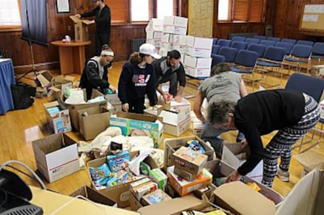 Residents from Beekman pack boxes of personal goods for soldiers serving overseas. The group filled more than 40 boxes.