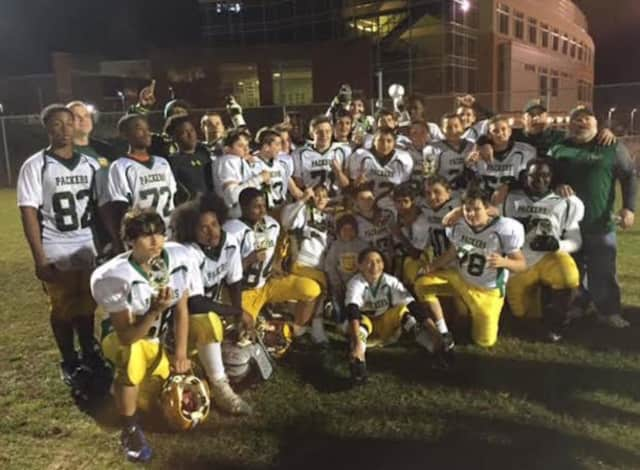The Norwalk Packers youth football team won the Colonial Youth Football Cheer 13-and-under league championship by ending New Britain's 29-game conference winning streak.