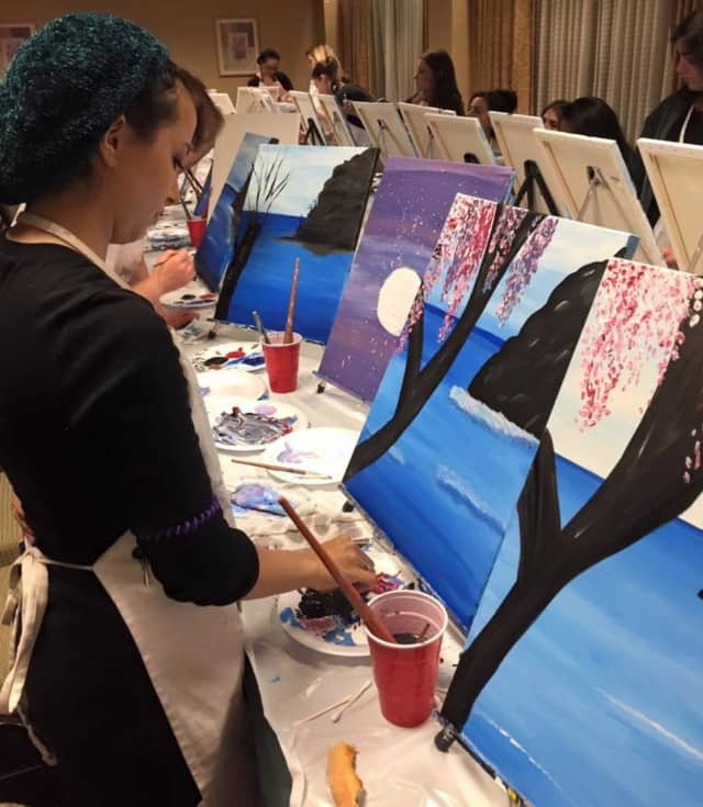 A Paint With Me student works on a painting. Paint With Me will have a session at Gotham Burger Buffet in Teaneck on Tuesday July 19.