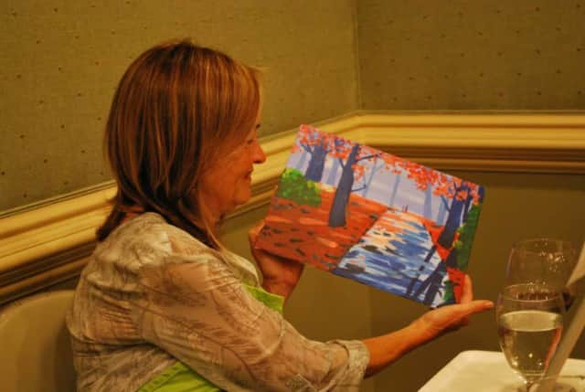 The Drawing Room Art Studio is bringing a painting class to the Woodstone Pizza Bar & Grill in mid-July.