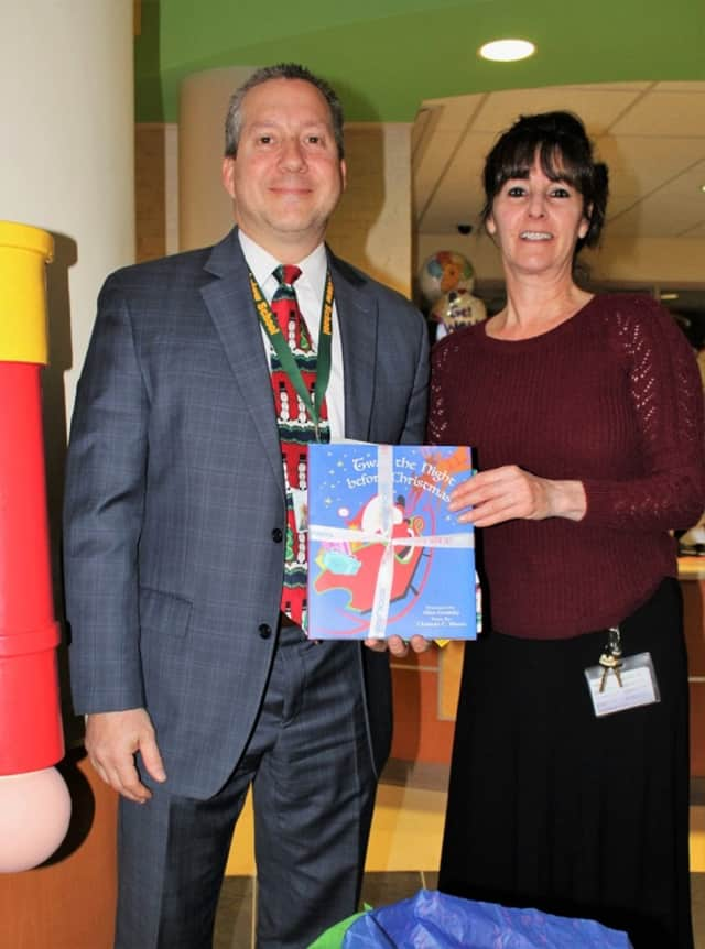 Principal Gary Mastrangelo poses with Debbie Sicari, Blythedale's coordinator of therapeutic recreation after dropping off pajamas donated by Greenburgh's Highview Elementary School .