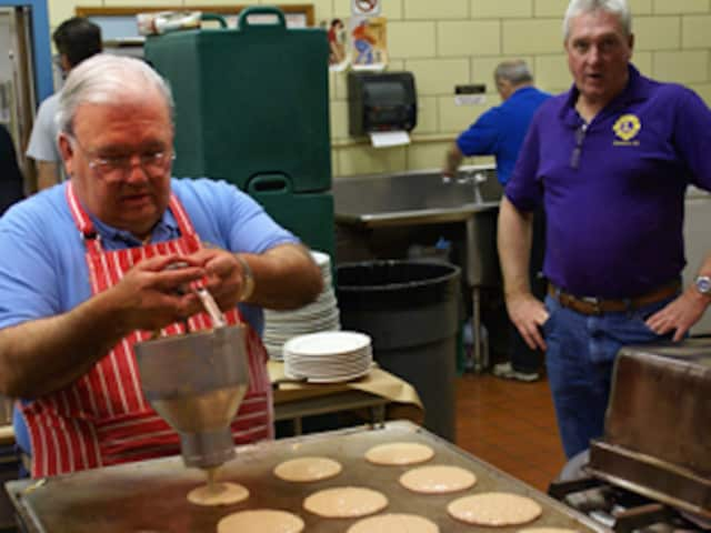 Members of Bergenfield Dumont Knights of Columbus make pancakes.