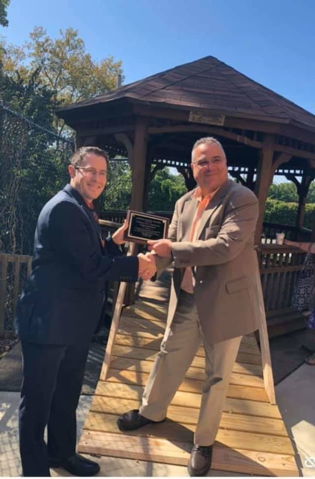 Doug DiPaola, right, receives an award from Paramus Home for Veterans CEO Matthew Schottlander after fixing the gazebo and building the ramp last summer.