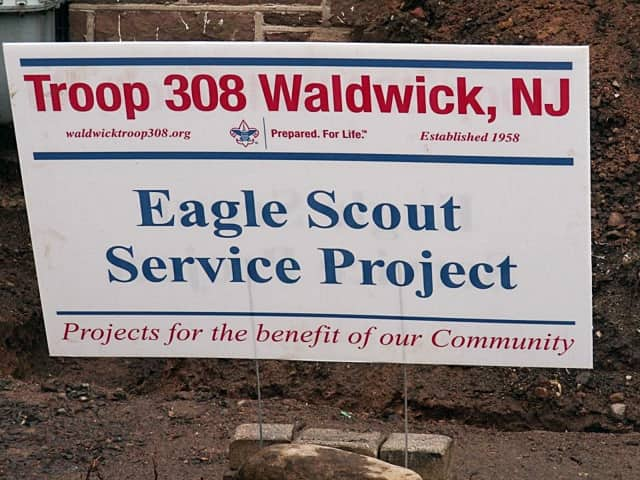 Waldwick boy scouts are at work to improve the public library.