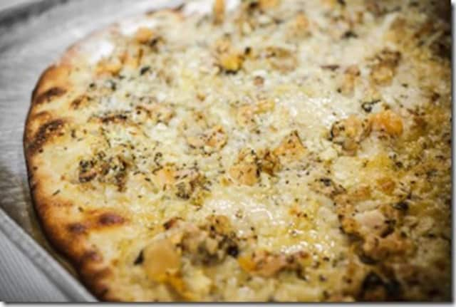 Frank Pepe's pizza is famous for its white clam pies.