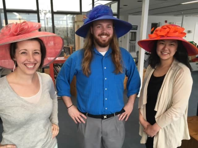 Pequot Library staffers Victoria Konopka, Jeffrey Brown and Priscilla Sato-Connell don their Derby Day best.