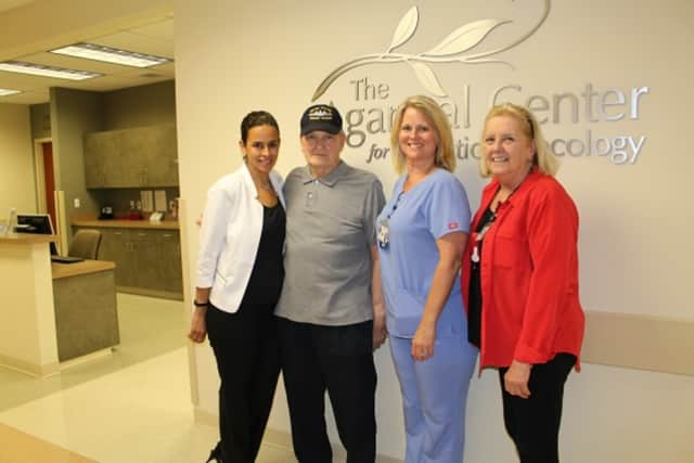 Peter Chisick with members of the radiation oncology team at Putnam Hospital Center including radiation therapy supervisor, Nicole Cimadomo (far left), registered nurse Diane Maher and oncology nurse navigator Dianne Toscano.