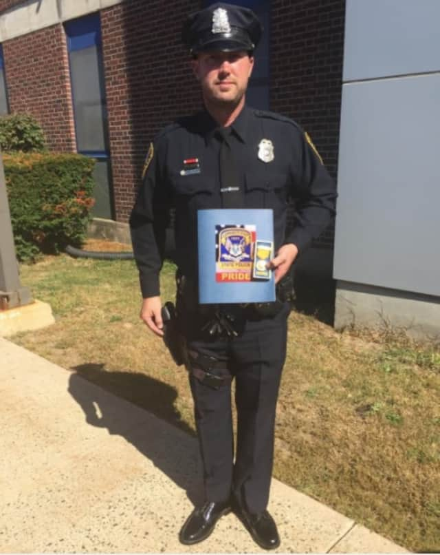 Norwalk Officer Dave Peterson was honored for providing aid during a serious motor vehicle accident.